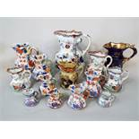 A comprehensive collection of 19th century Mason's ironstone and similar jugs, mainly of octagonal