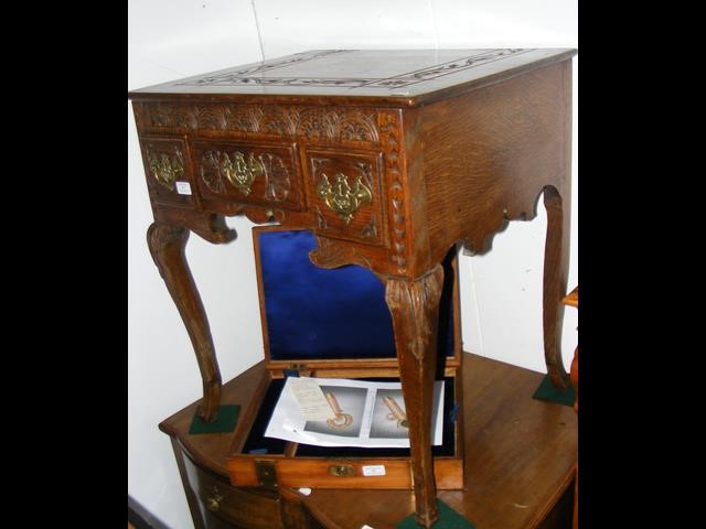 Lot 57 - A Georgian oak lowboy with later carving and cabri