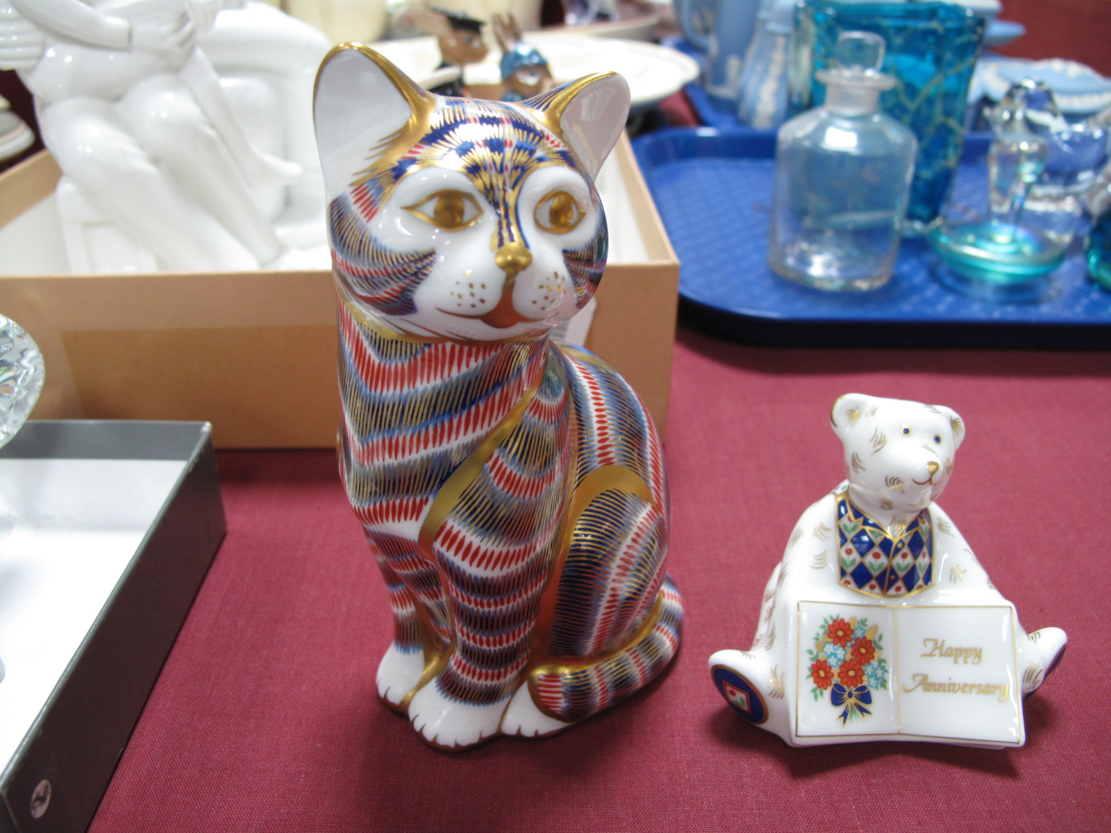 Lot 46 - Royal Crown Derby Imari cat, with a silver seal; together with a Royal Crown Derby Happy Anniversary