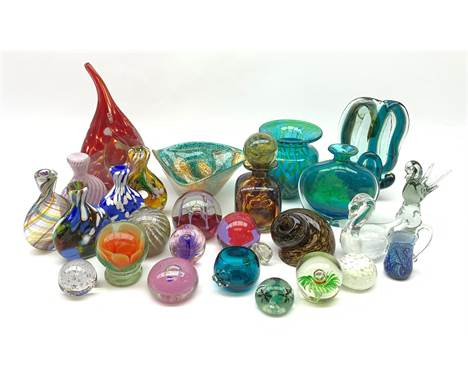 Mdina glass comprising a sculptural glass paperweight, bottle and stopper, vase of teardrop form, two vases and a dish, toget