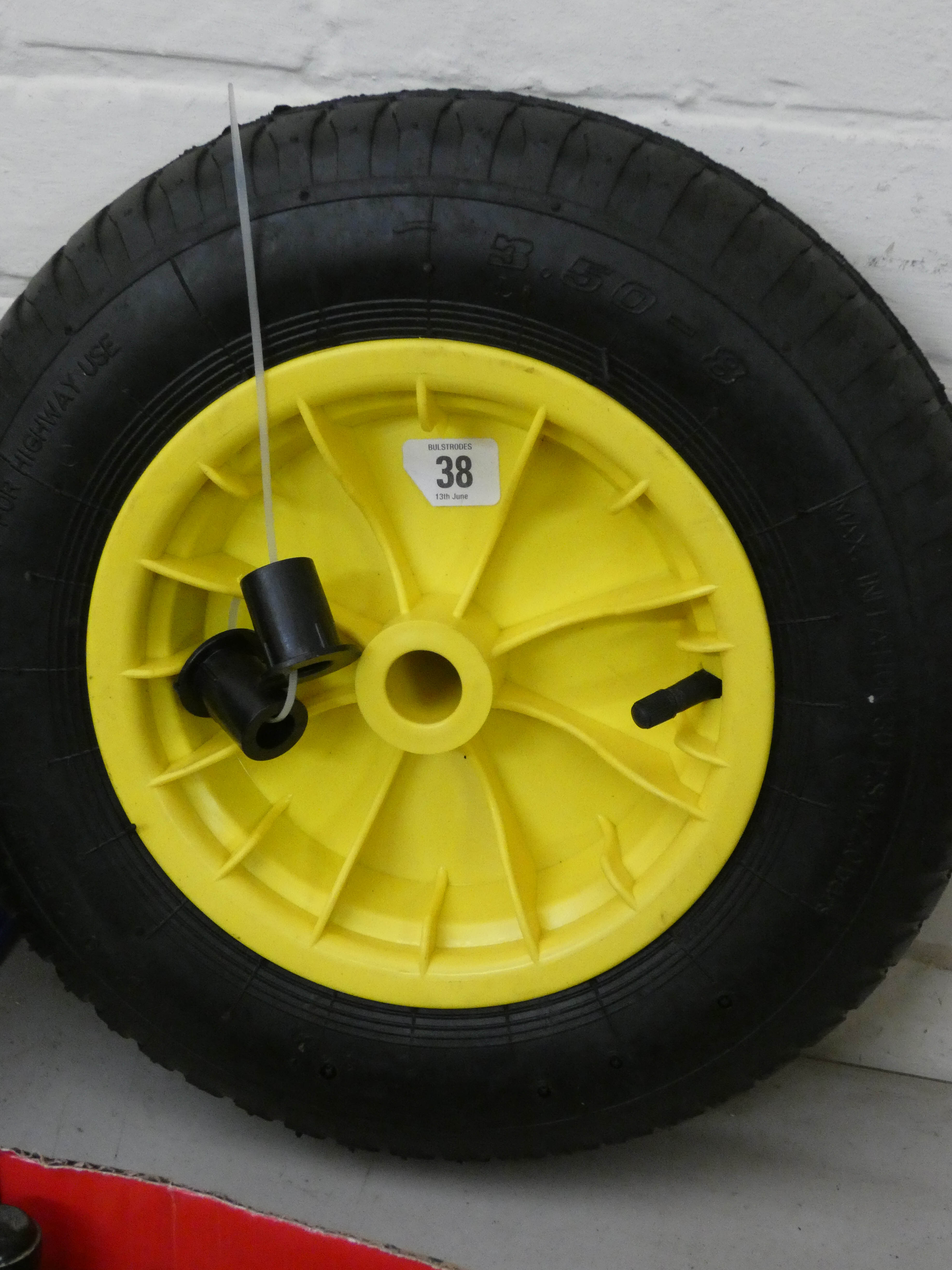 Lot 38 - A new wheelbarrow wheel with Numatic tyre and two spacers