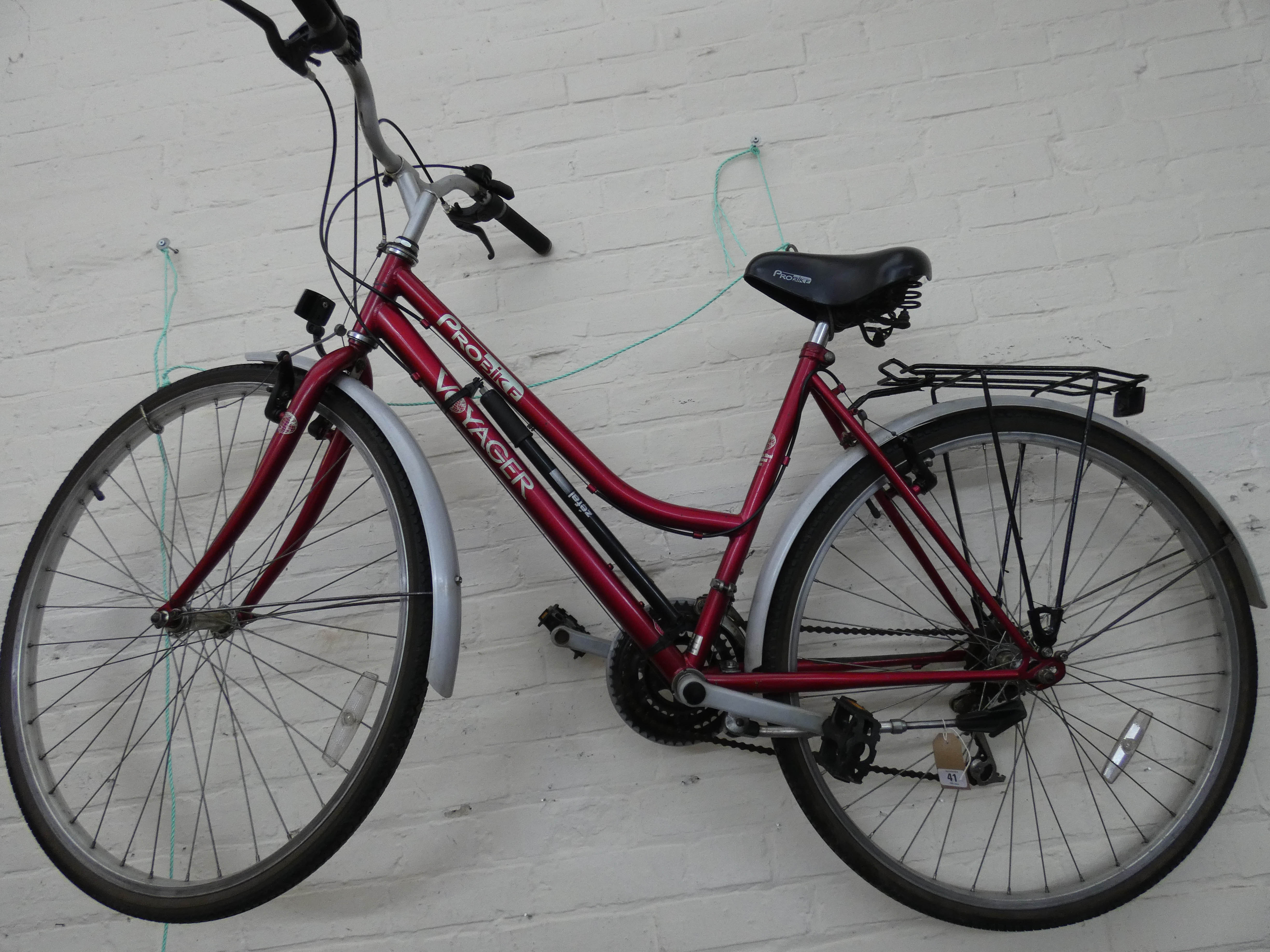 Lot 41 - A mauve and silver Pro-bike Voyager ladies bicycle with rear rack