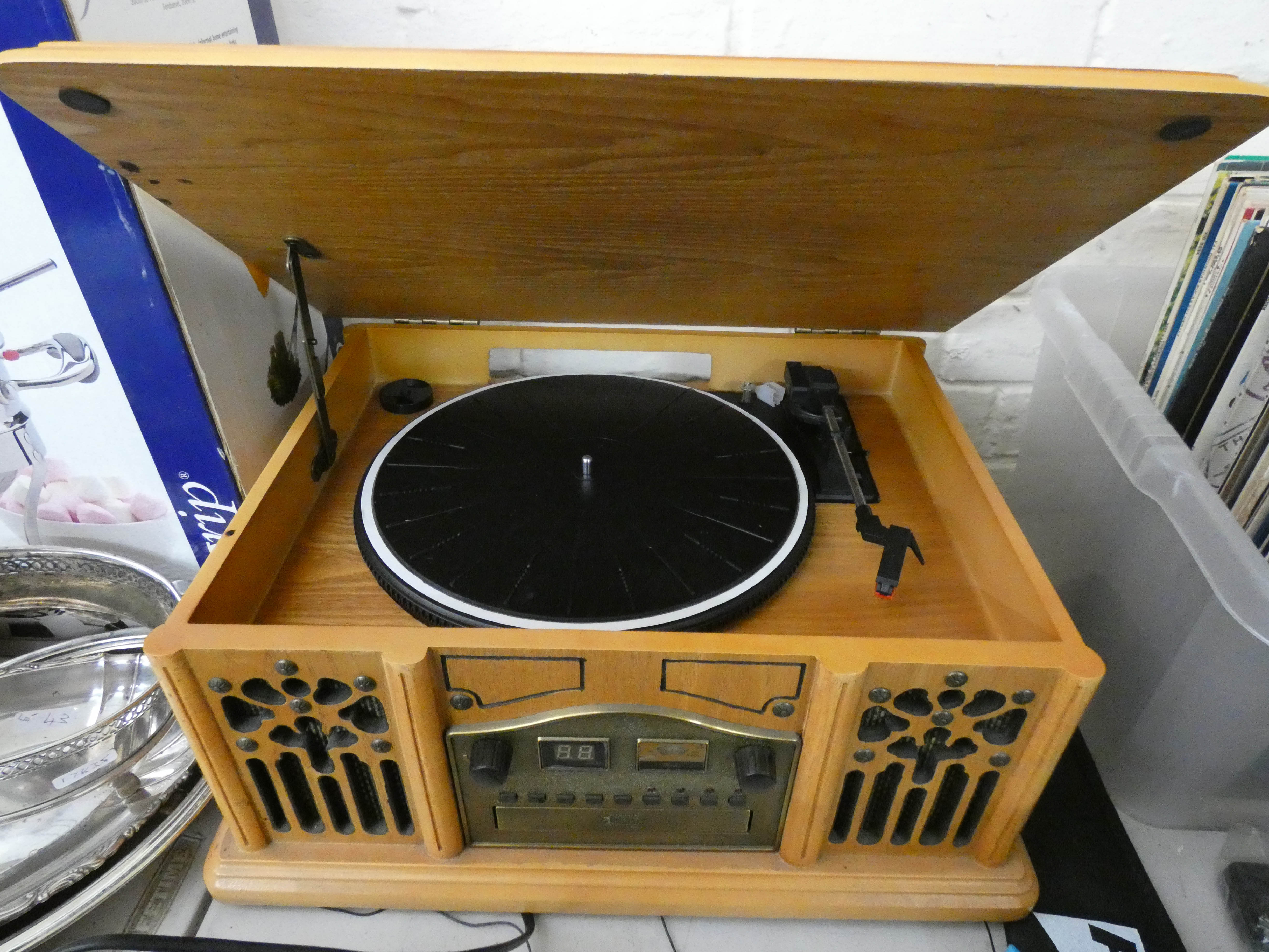 Lot 44 - A CD radio player in an old style wooden case