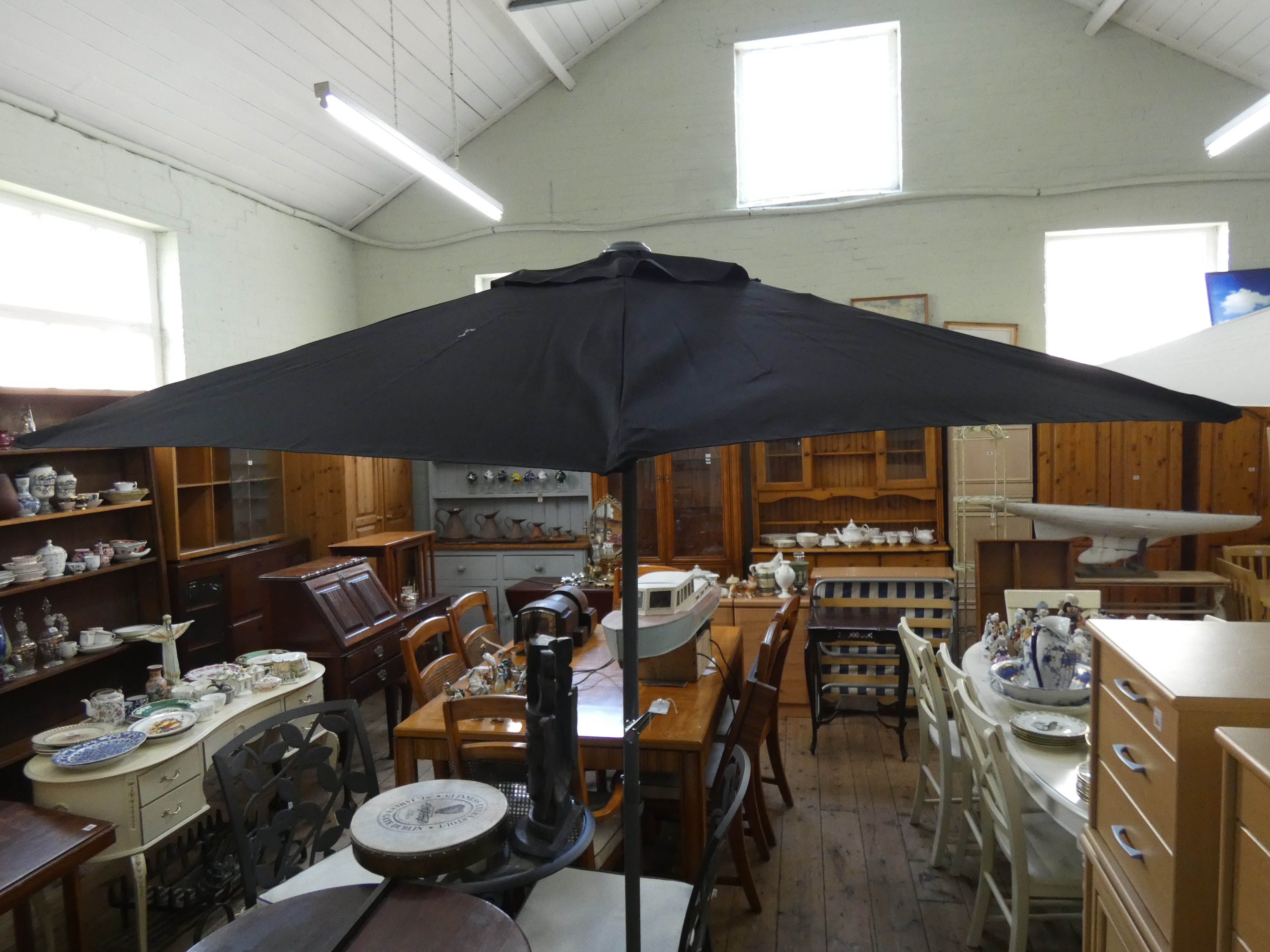 Lot 3 - A new wind up garden parasol with heavy stabilising base and black cover