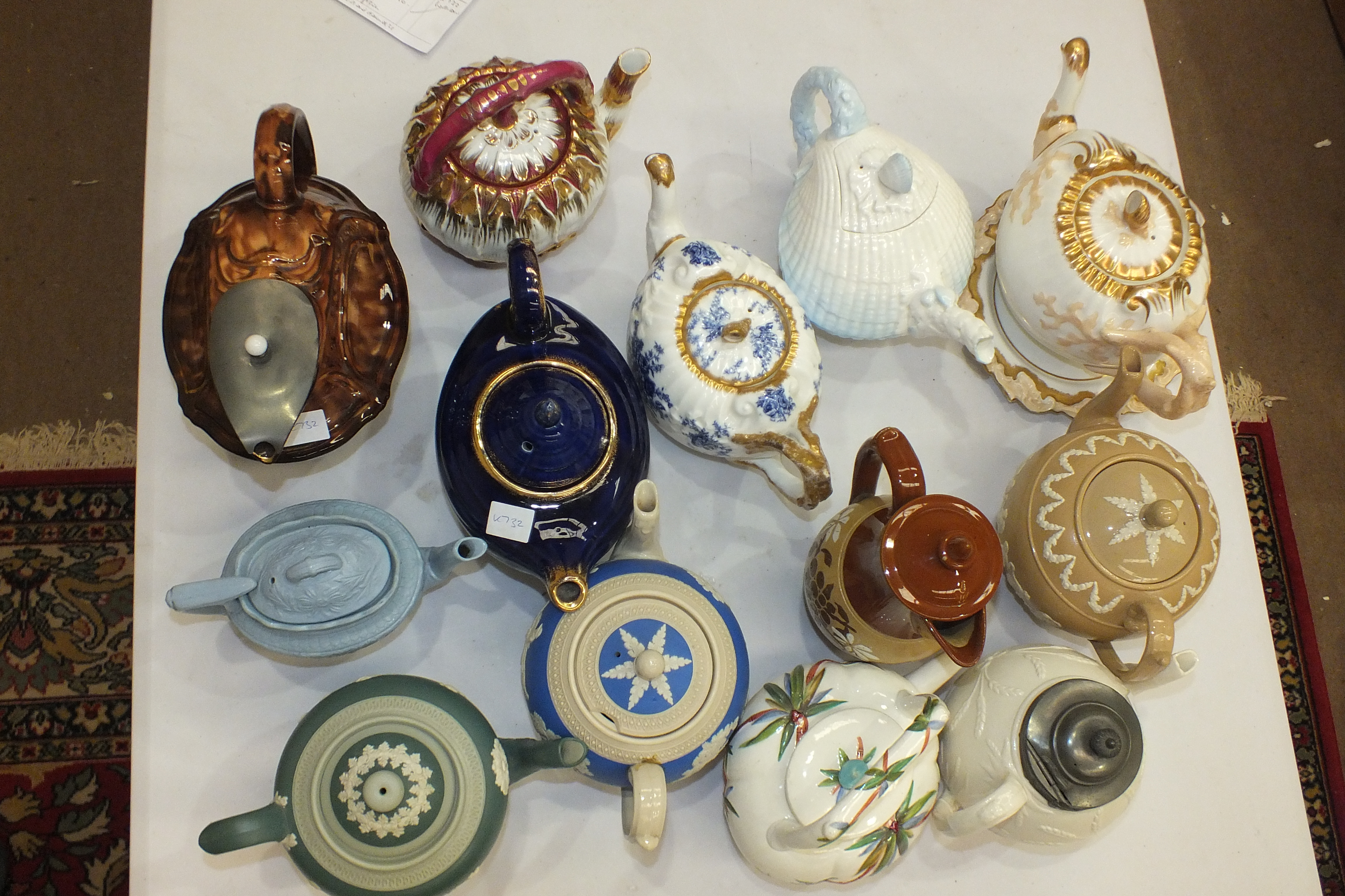 Lot 113 - A William Brownfield & Sons novelty teapot in the form of a cockle shell, with finialled lid,