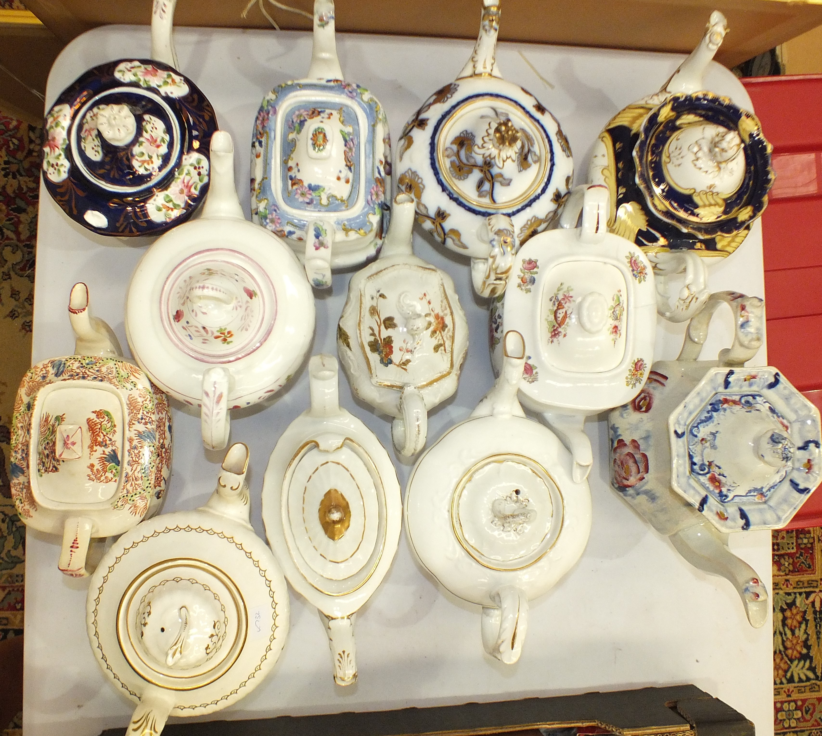A collection of twelve 19th century and later ceramic teapots.