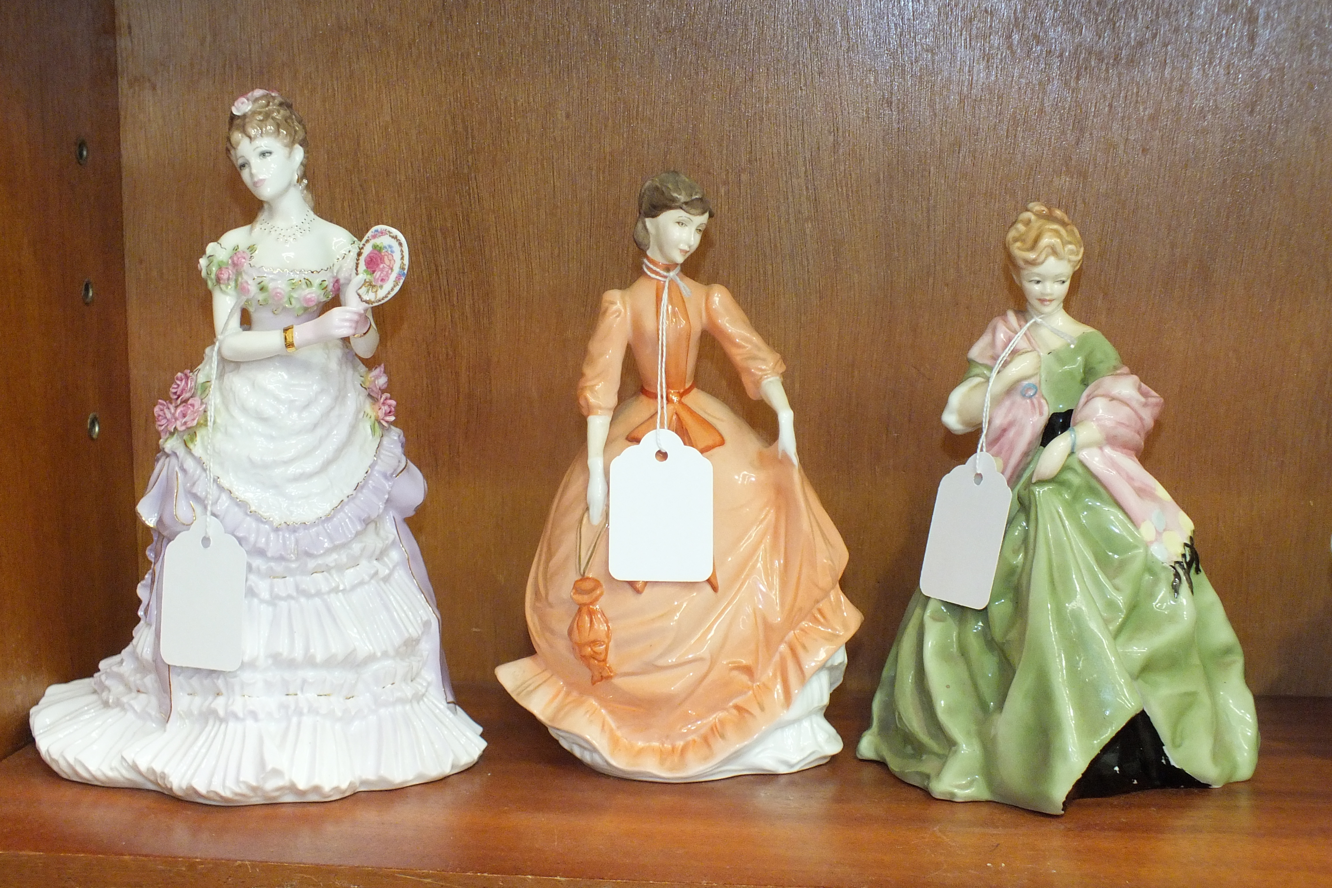 Lot 138 - A Royal Worcester figurine 'First Dance', modelled by F C Doughty and two others, 'Charity' and '