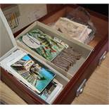 A suitcase of assorted tea cards, loose stamps, Royal ephemera etc