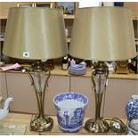 A pair of cut glass and brass lamps with shades
