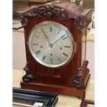 A Victorian mahogany repeating bracket clock having silvered Roman dial, striking and chiming on