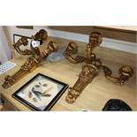 A pair of three branch gilt lion decorated sconces height 56cm