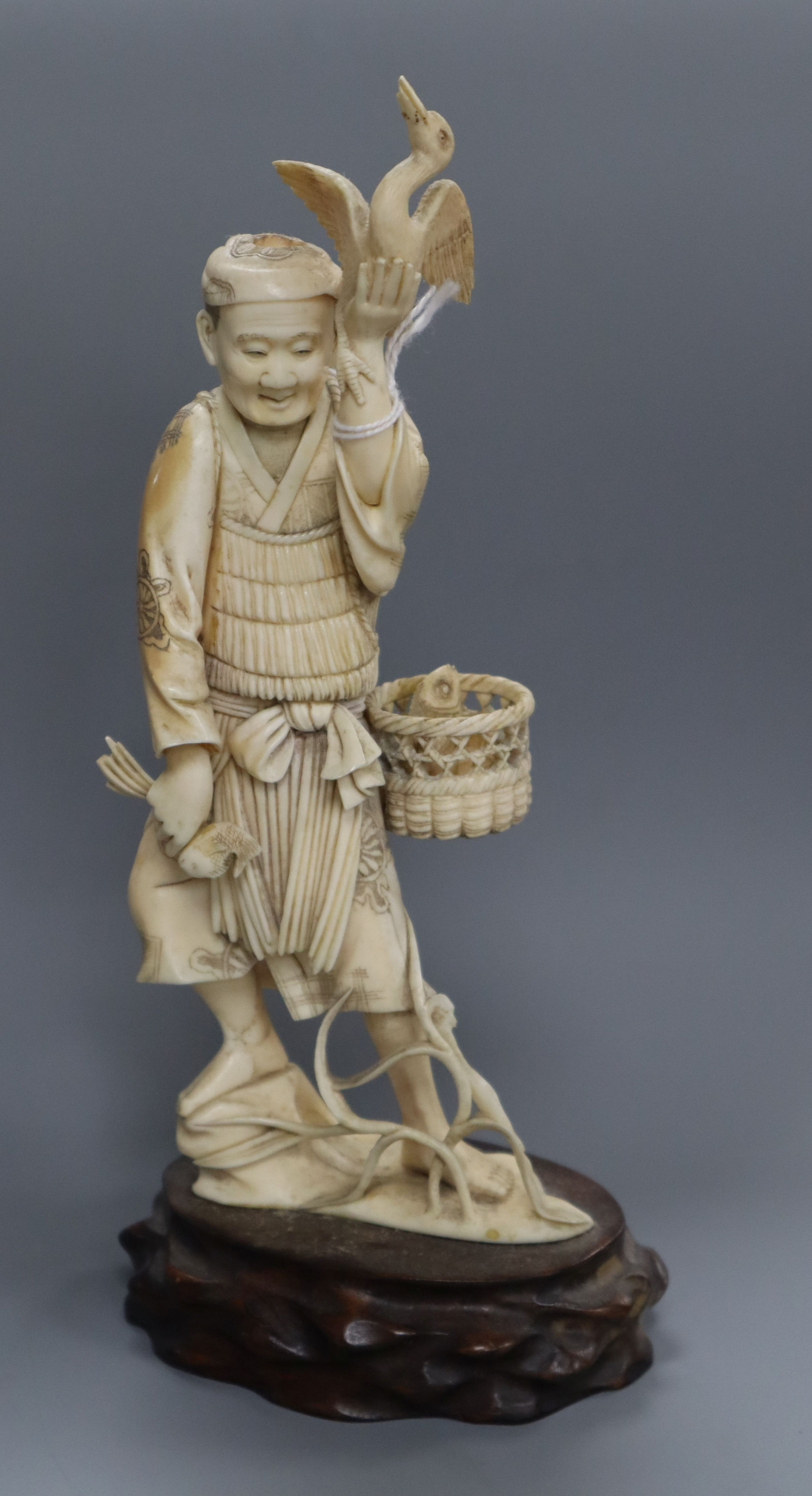 A Japanese ivory figure of a cormorant fisherman, early 20th century height 24cm