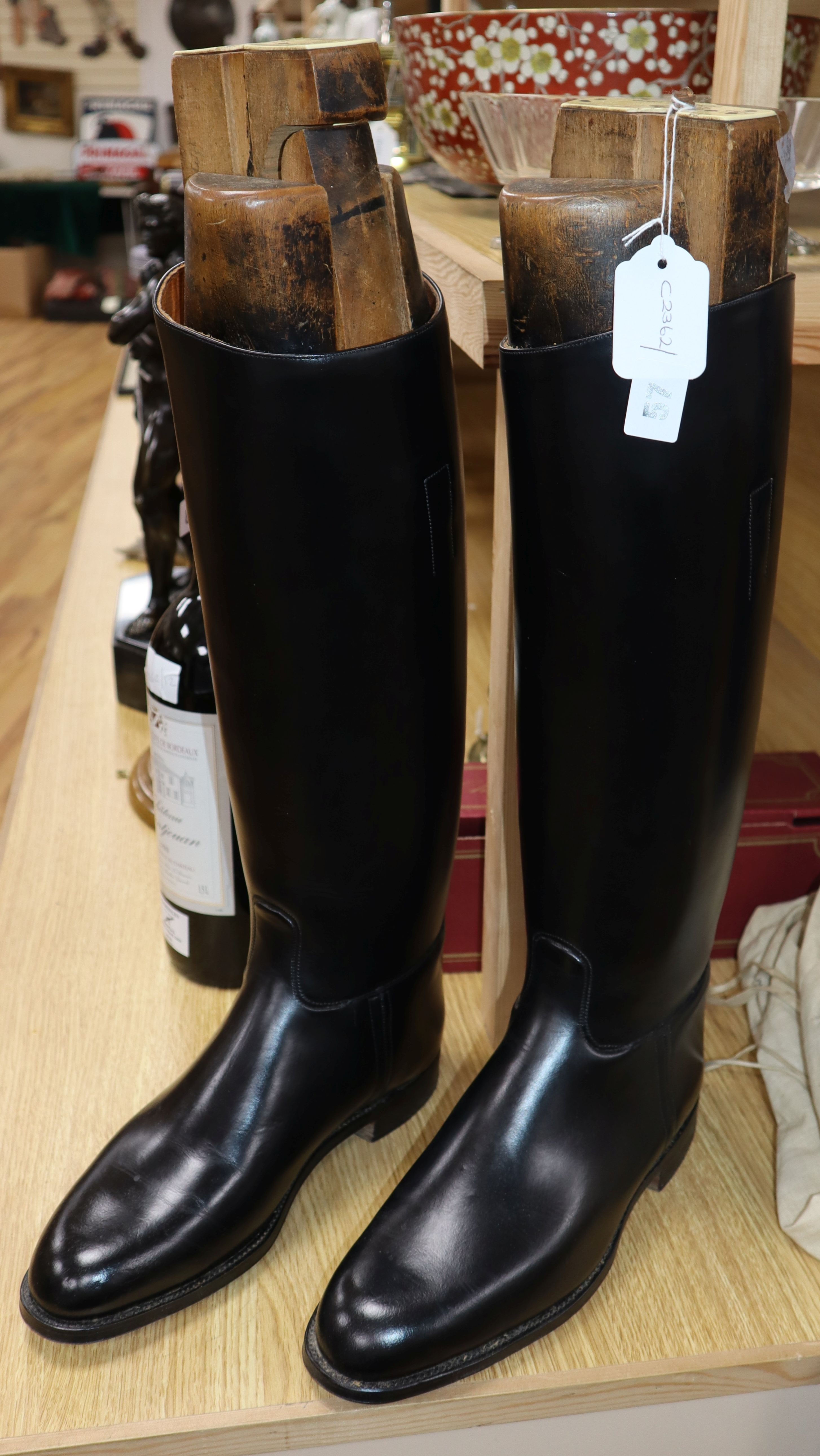 A pair of black leather riding boots, the trees bearing ivorine plaques inscribed 'Viscount