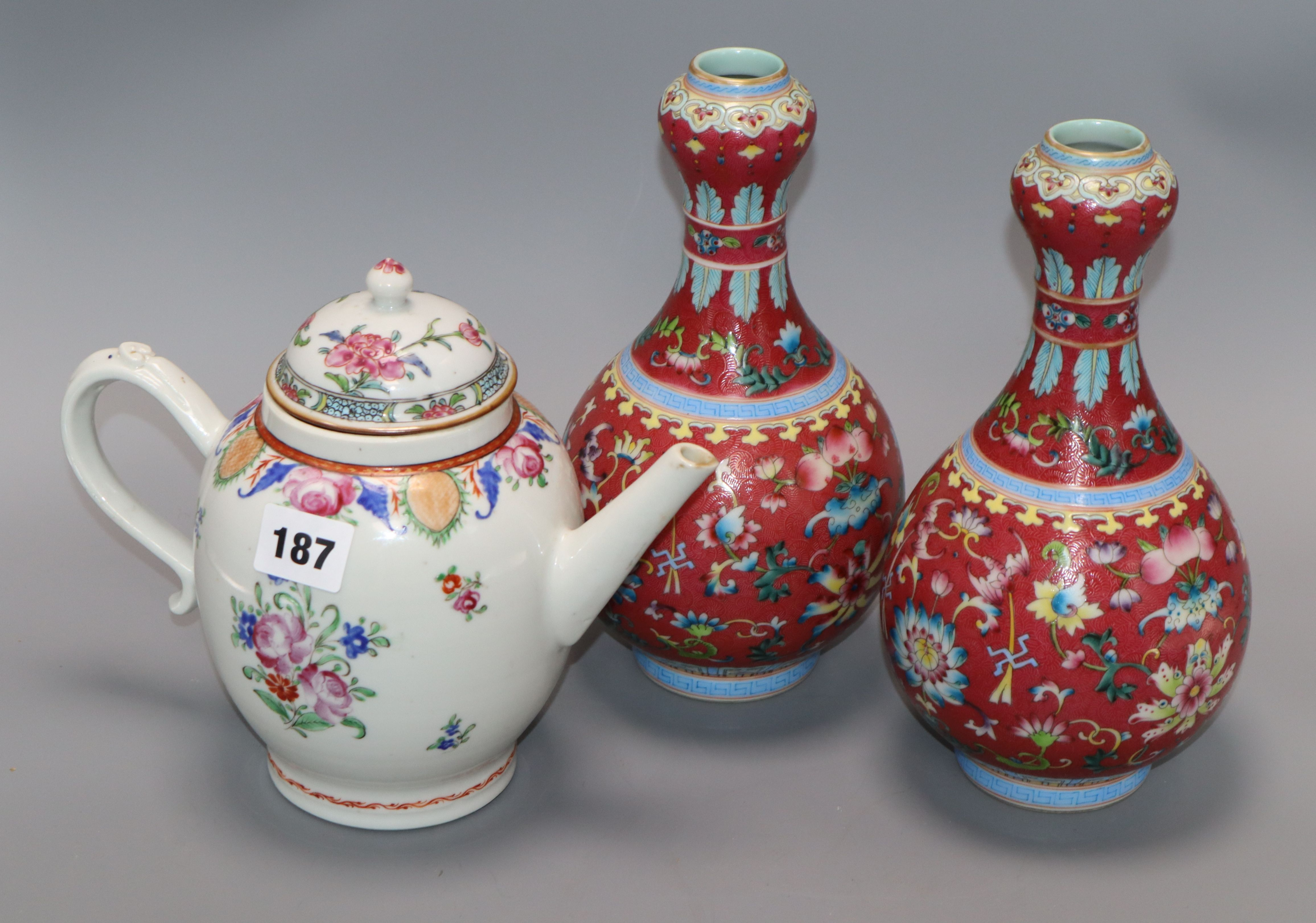 A pair of Chinese garlic neck vases and a famille rose teapot