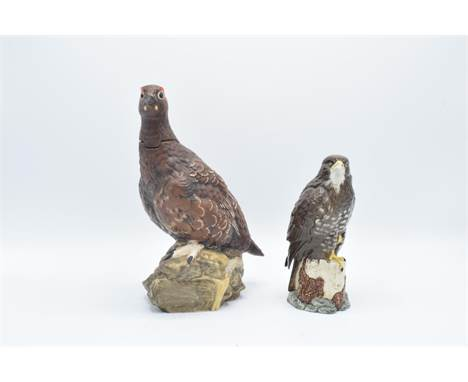 Royal Doulton buzzard whiskey decanter and The Famous Grouse decanter (2) In good condition without any obvious damage or res