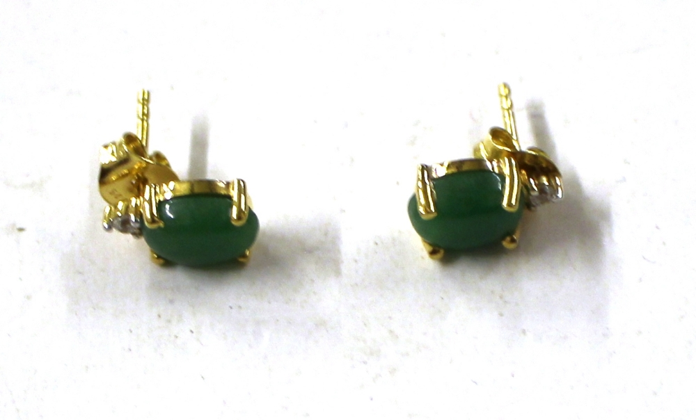 Lot 816 - A pair of Sterling silver green jade set ear-rings
