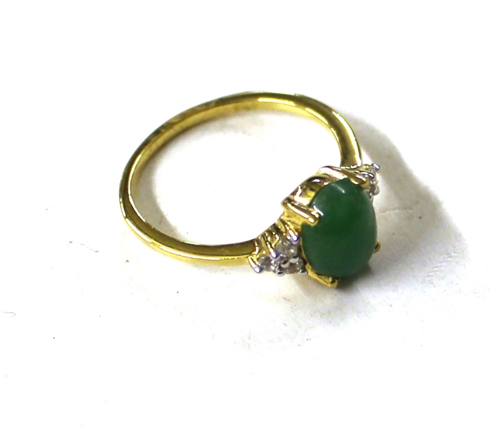 Lot 818 - A Sterling silver green jade set ring with natural