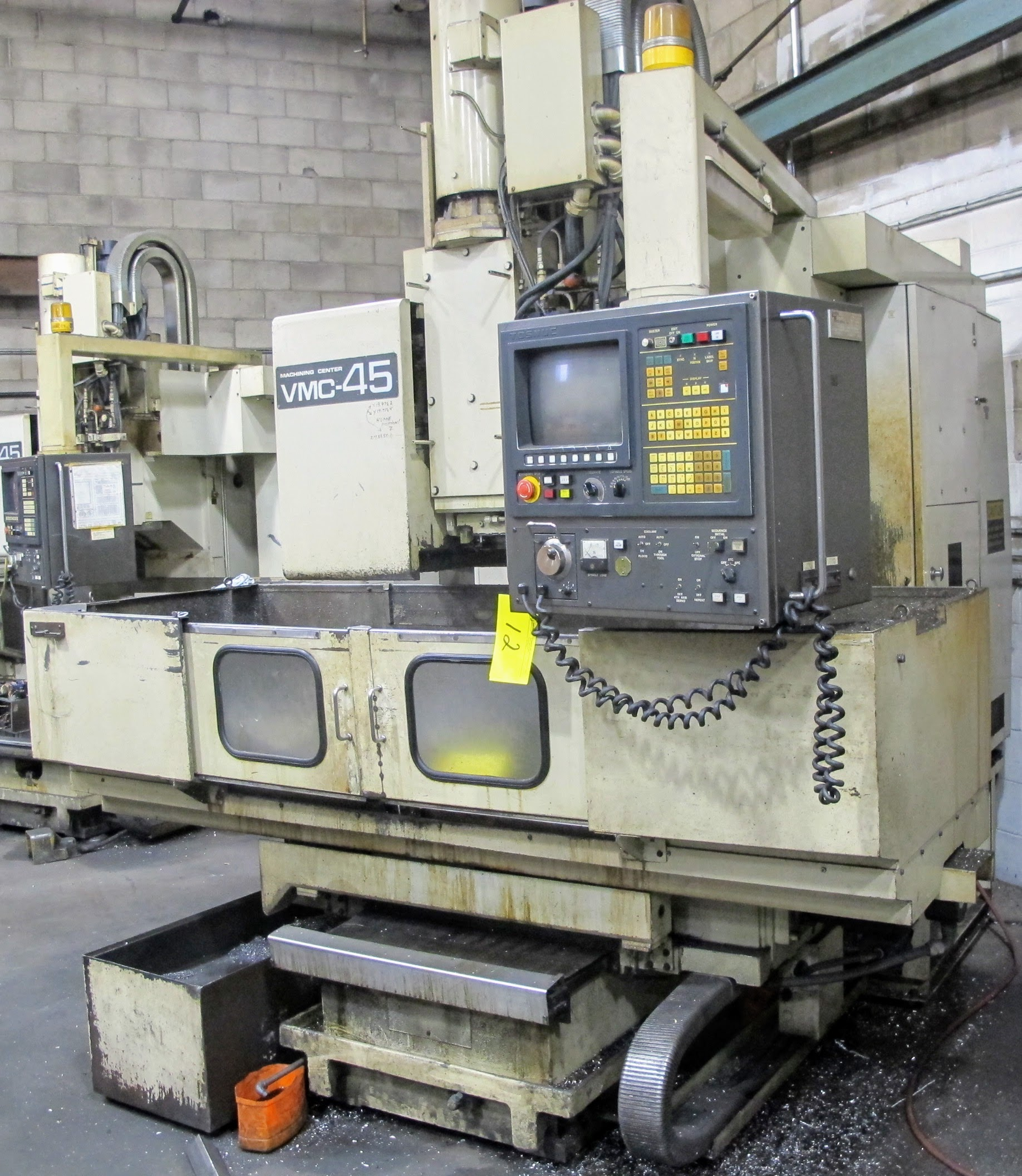 "SHIBAURA VMC-45 CNC VERTICAL MACHINING CENTER, 18"" X 40"" TABLE, TOSNUC CNC CONTROLS, 20 ATC, COOLING"