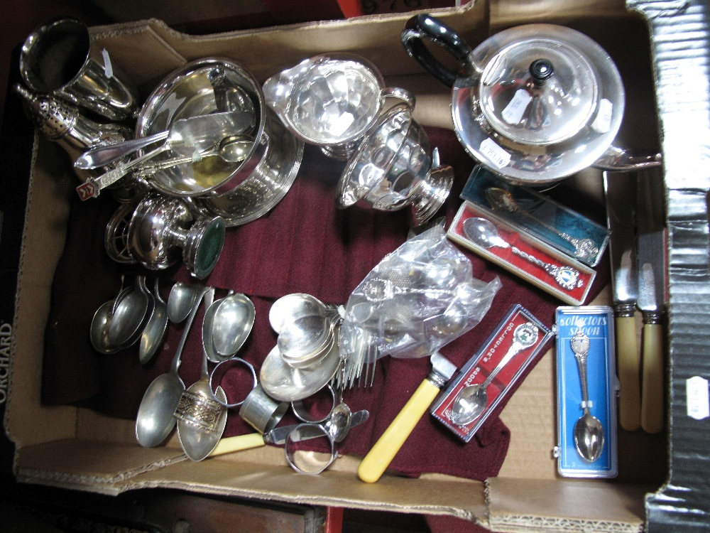 Lot 22 - A Plated Three Piece Teaset, assorted cutlery sugar caster, napkin rings, souvenir teaspoons, mini