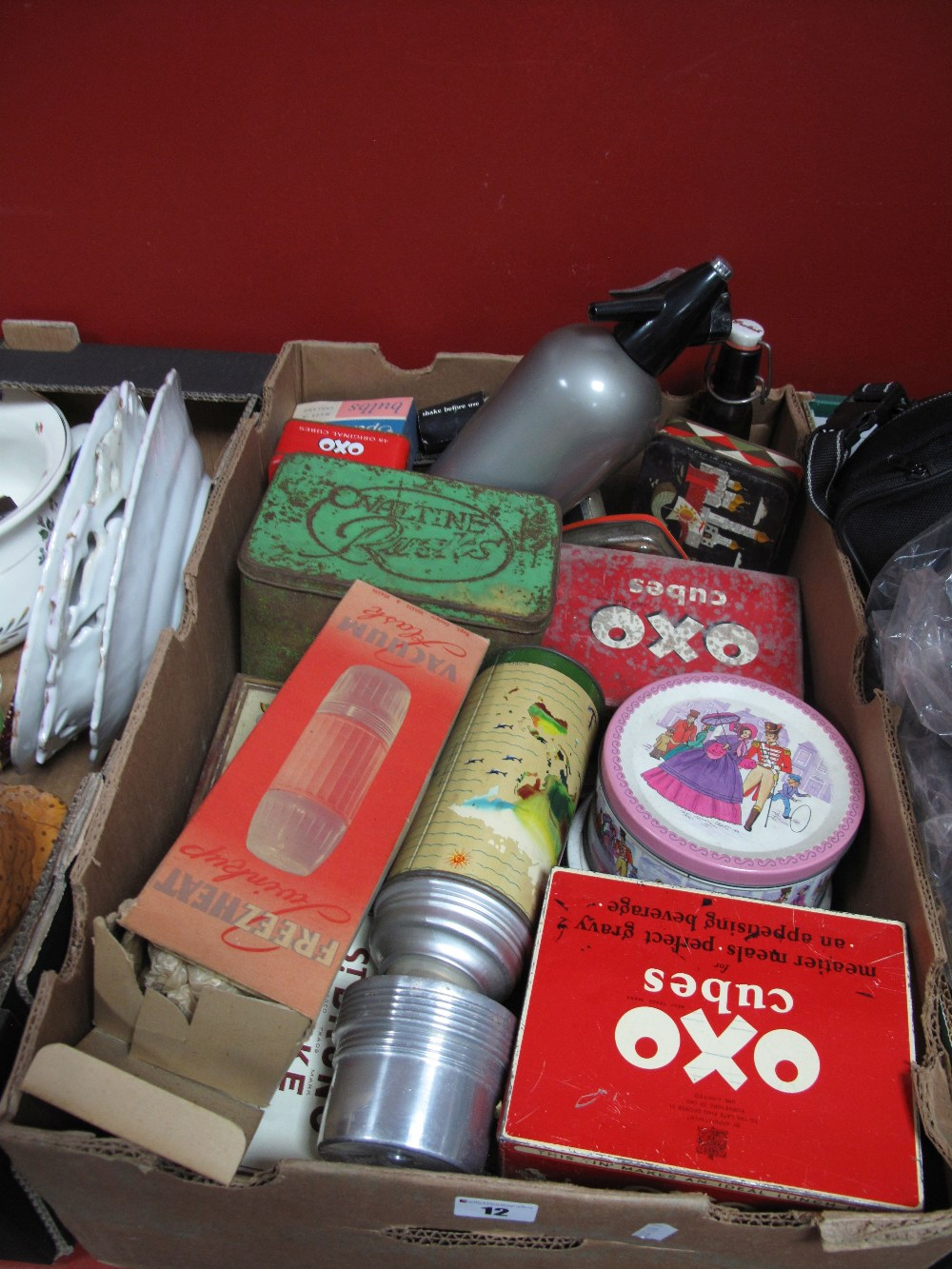 Lot 12 - A Quantity of Tins, soda syphon, thermos flask, etc:- One Box