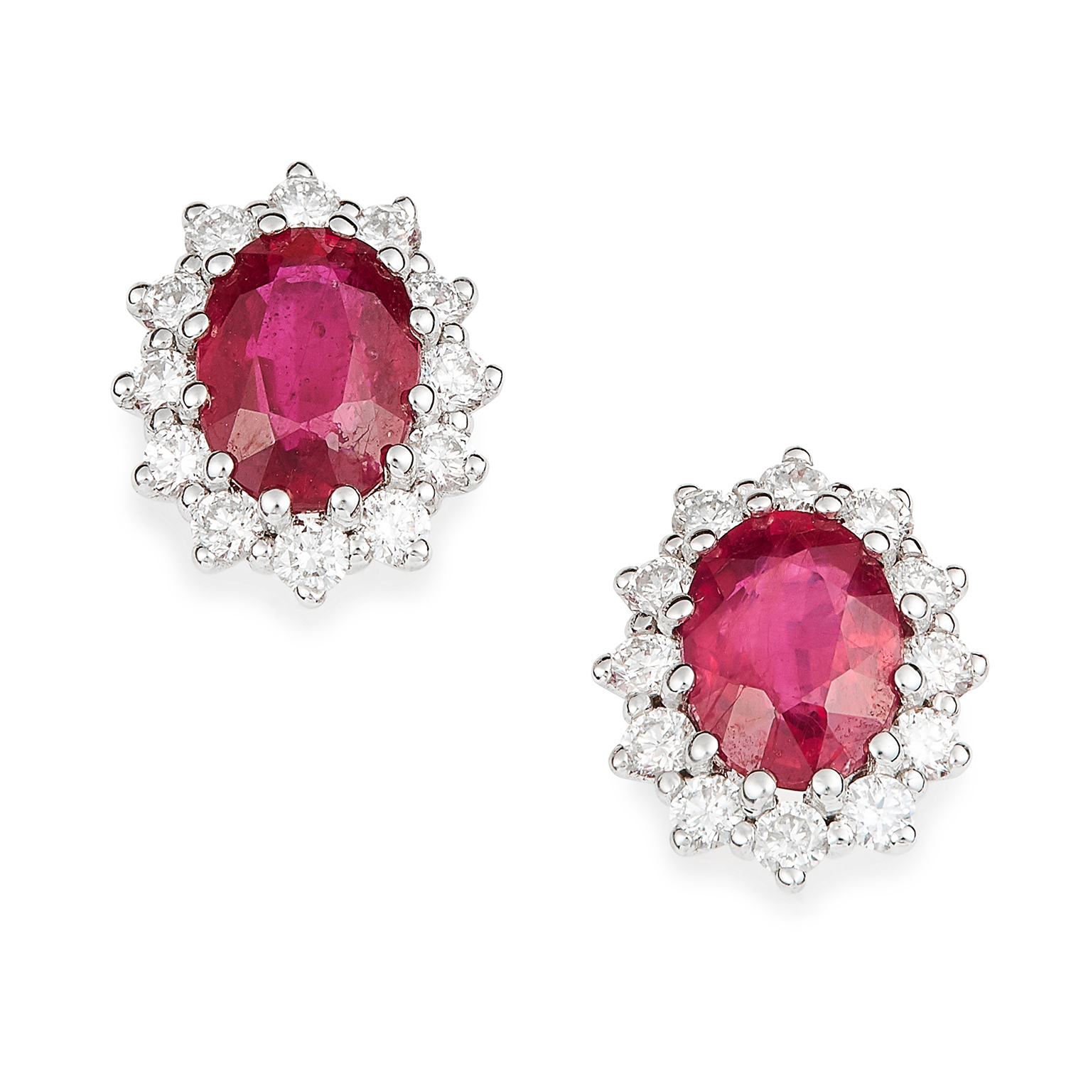 RUBY AND DIAMOND CLUSTER EARRINGS in 18ct white gold, each set with an oval cut ruby in a cluster of