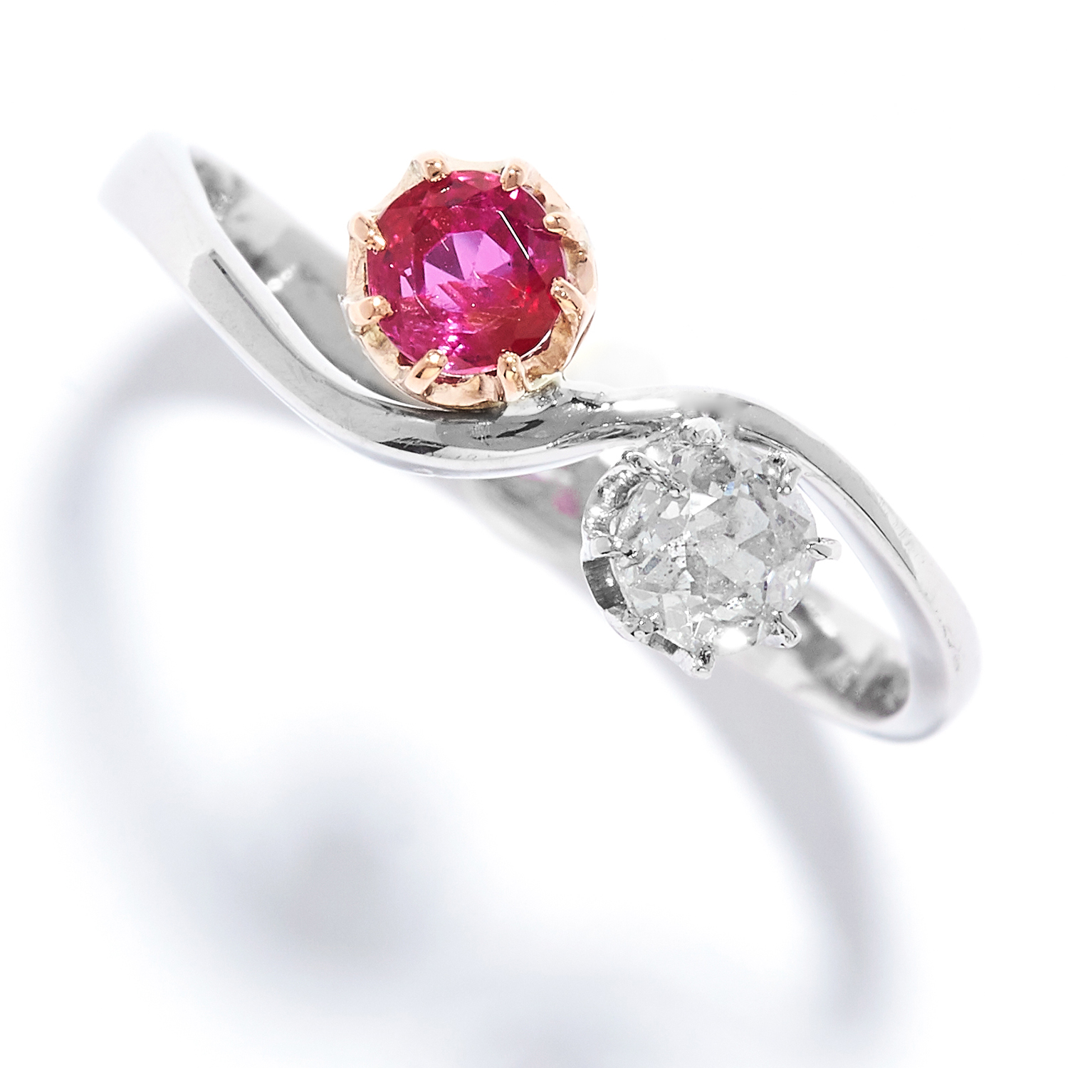 RUBY AND DIAMOND TOI ET MOI RING in platinum, set with a round cut ruby and diamond, stamped