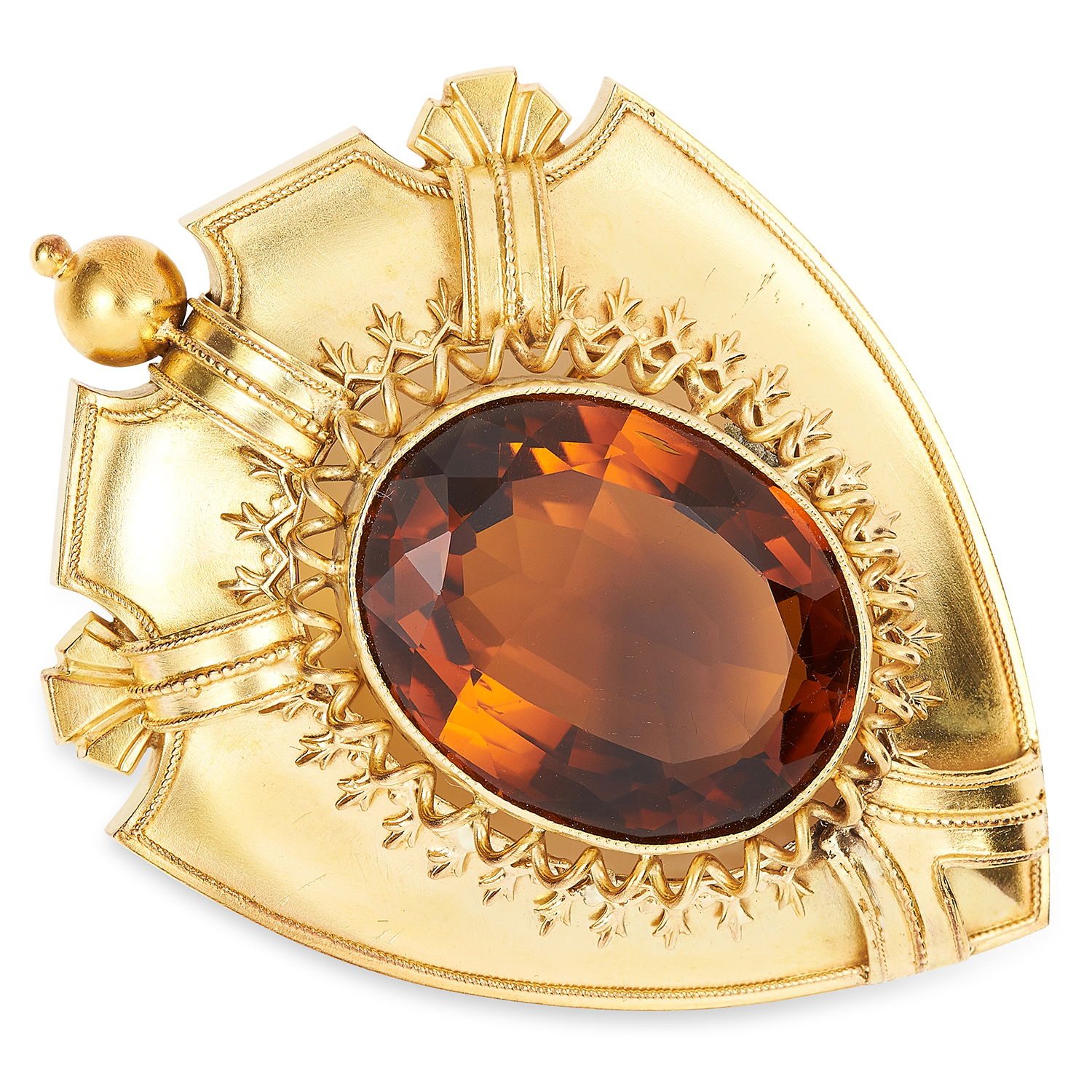 ANTIQUE VICTORIAN CITRINE BROOCH in high carat yellow gold, depicting a shield set with an oval