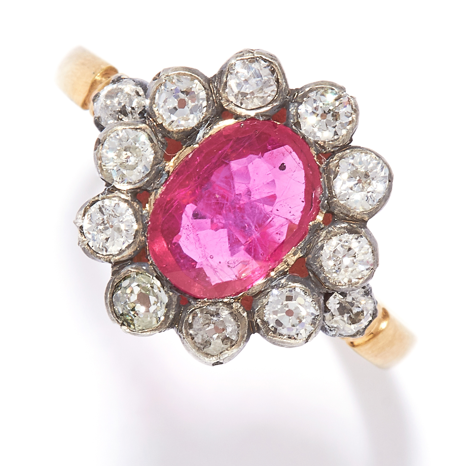 RUBY AND DIAMOND CLUSTER RING in yellow gold, set with an oval cut ruby in a cluster of round cut