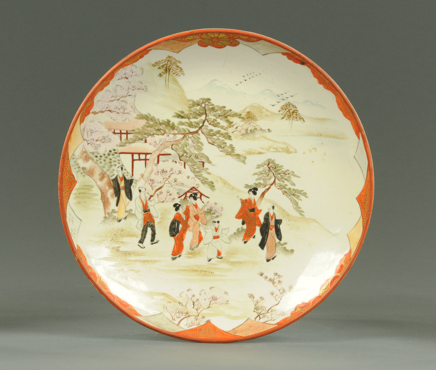 Lot 12 - An early 20th century Kutani plate, decorated in typical Kutani colours. Diameter 32 cm.