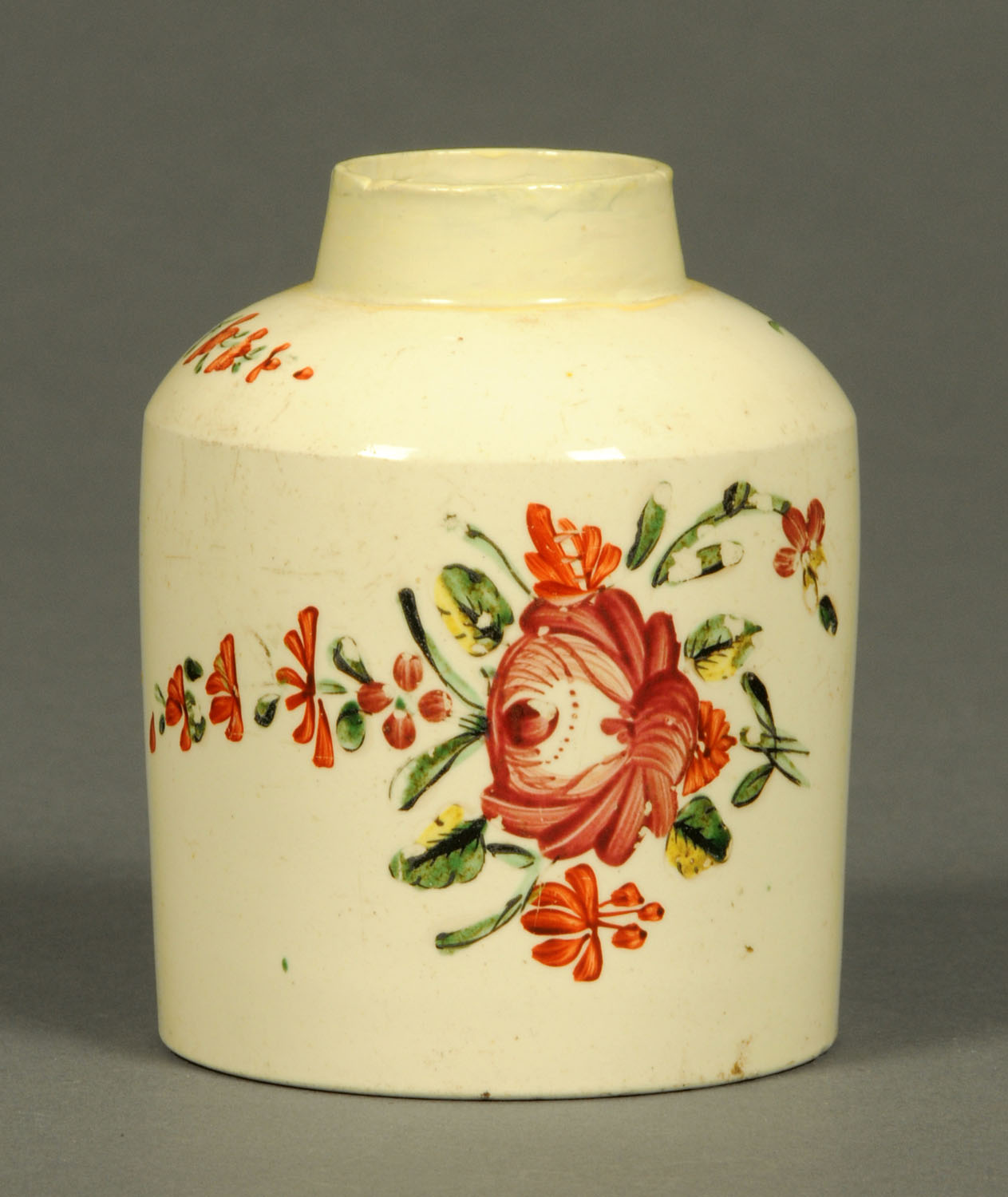 Lot 16 - A creamware tea caddy, decorated with floral bouquet and sprigs (lid lacking). Length 10 cm.