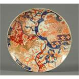A Japanese Imari plate, late 19th century, decorated in typical Imari colours with gilding.