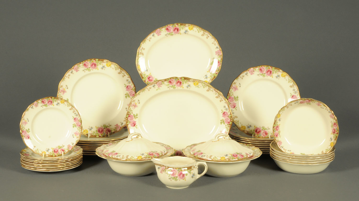 Lot 9 - A Royal Doulton English Rose patterned part dinner service, 9 dinner plates, 9 medium plates,