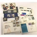 A collection of first day covers together with 2 commemorative Charles and Diana wedding coins