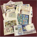 A collection of world stamp sets and mini sheets.
