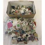A box of assorted vintage British and foreign loose, used stamps.
