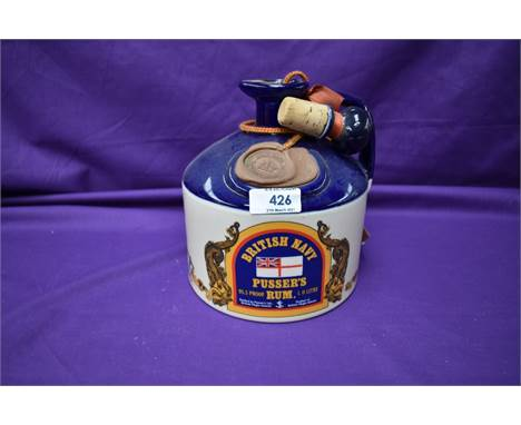 A Ceramic Decanter of British Navy Pussers Rum, with stopper, British Virgin Islands. 1 litre, 95.5 proof. CONDITION REPORT L