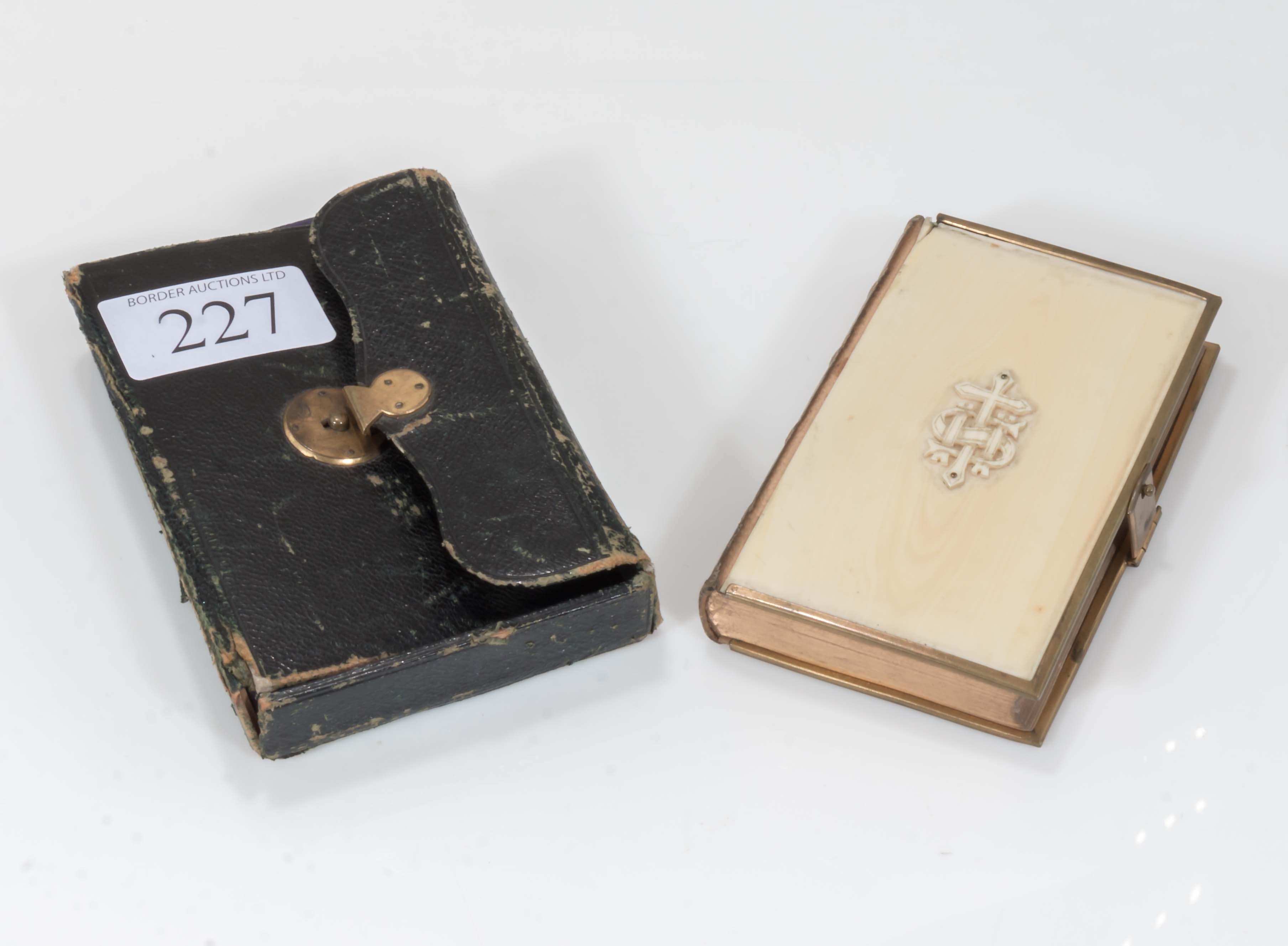 Lot 227 - An Ivory backed bible in leather case