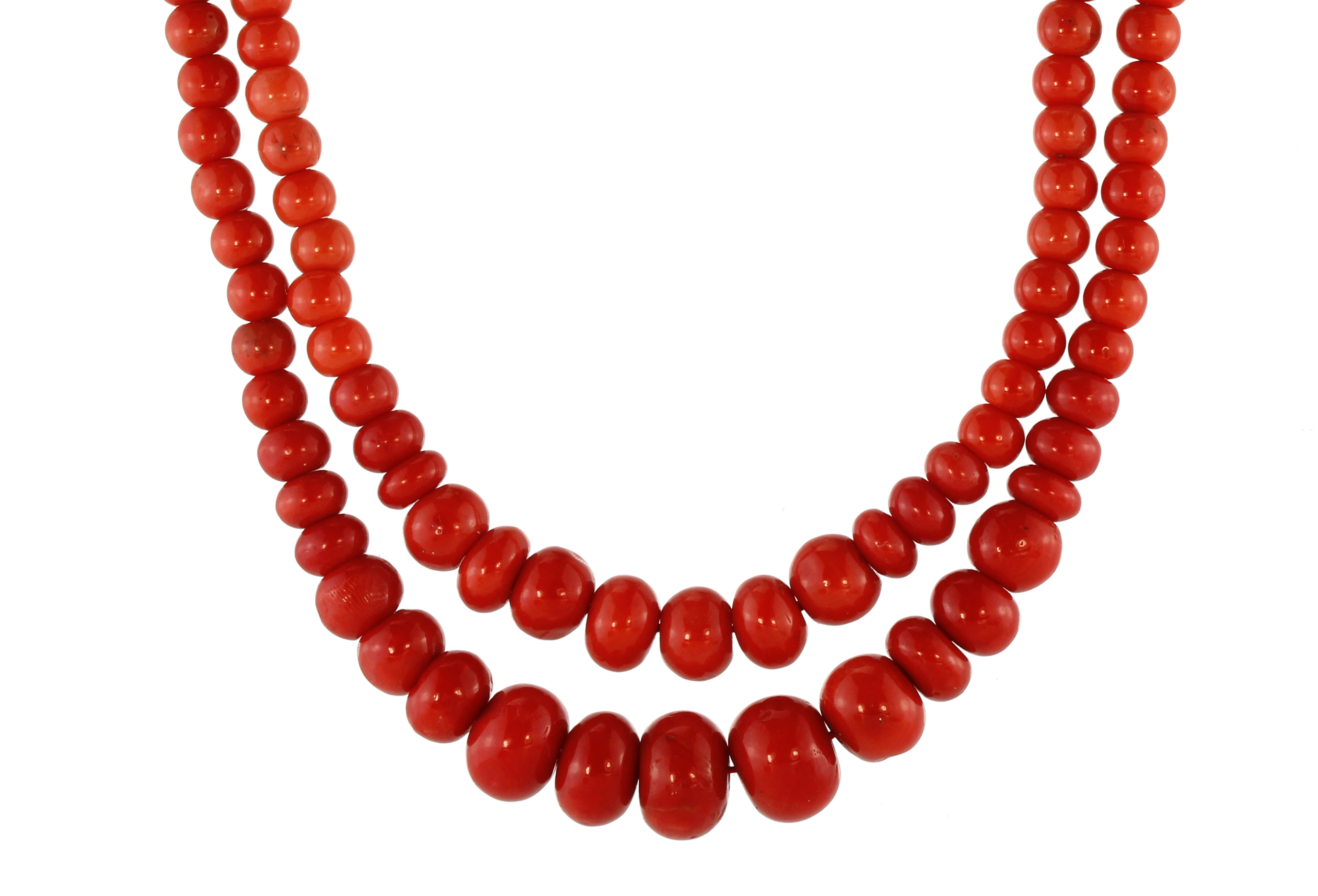 A fine Italian coral bead necklace in 18ct yellow gold designed as two strands of graduated round