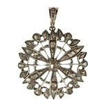 A large diamond flower pendant in gold and silver designed as a flower motif, set with a central