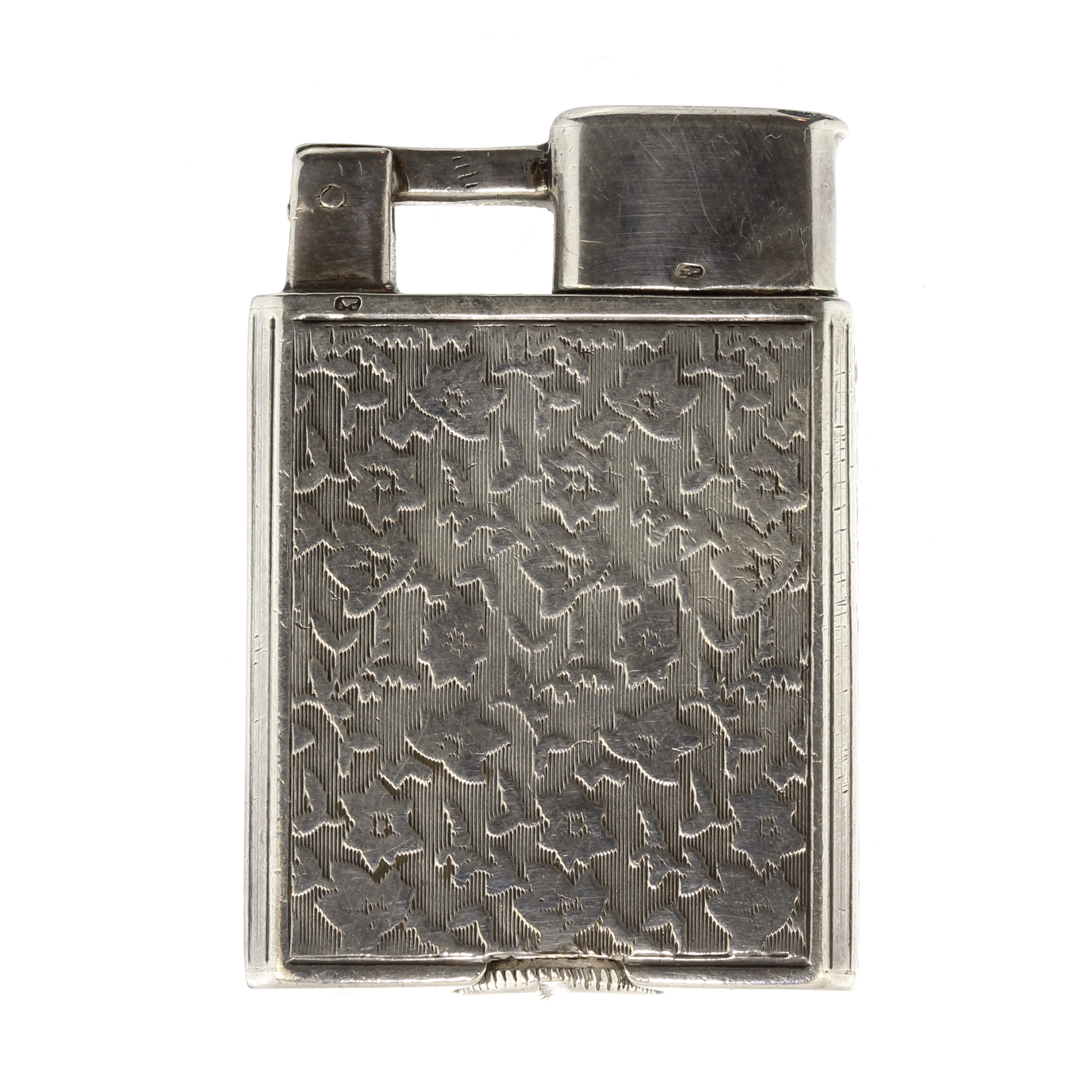 Los 242 - An antique Sterling silver cigarette lighter the rectangular body with flat chased floral decoration