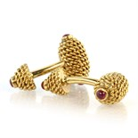 TIFFANY & CO A pair of ruby cufflinks in 18ct yellow gold by Tiffany & Co each designed as two links