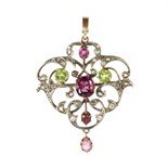 An antique Victorian garnet, peridot and diamond pendant in yellow gold designed as a belle epoque