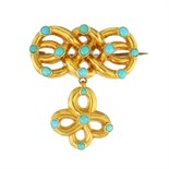 An antique Victorian turquoise bead & hairwork mourning brooch in 15ct yellow gold with an