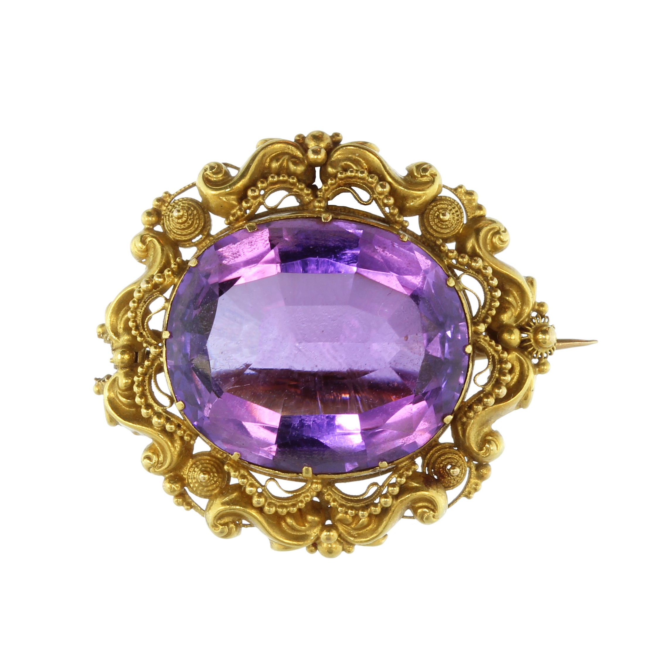 Los 9 - An antique 19th Century amethyst brooch in yellow gold set with a large oval cut amethyst weighing