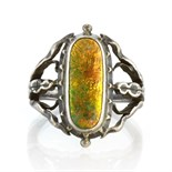 An antique Arts & Crafts enamel and sterling silver ring by the Guild of Handicrafts set with an