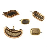 Five antique Georgian hairwork mourning brooches in yellow gold one of kidney form with an inset