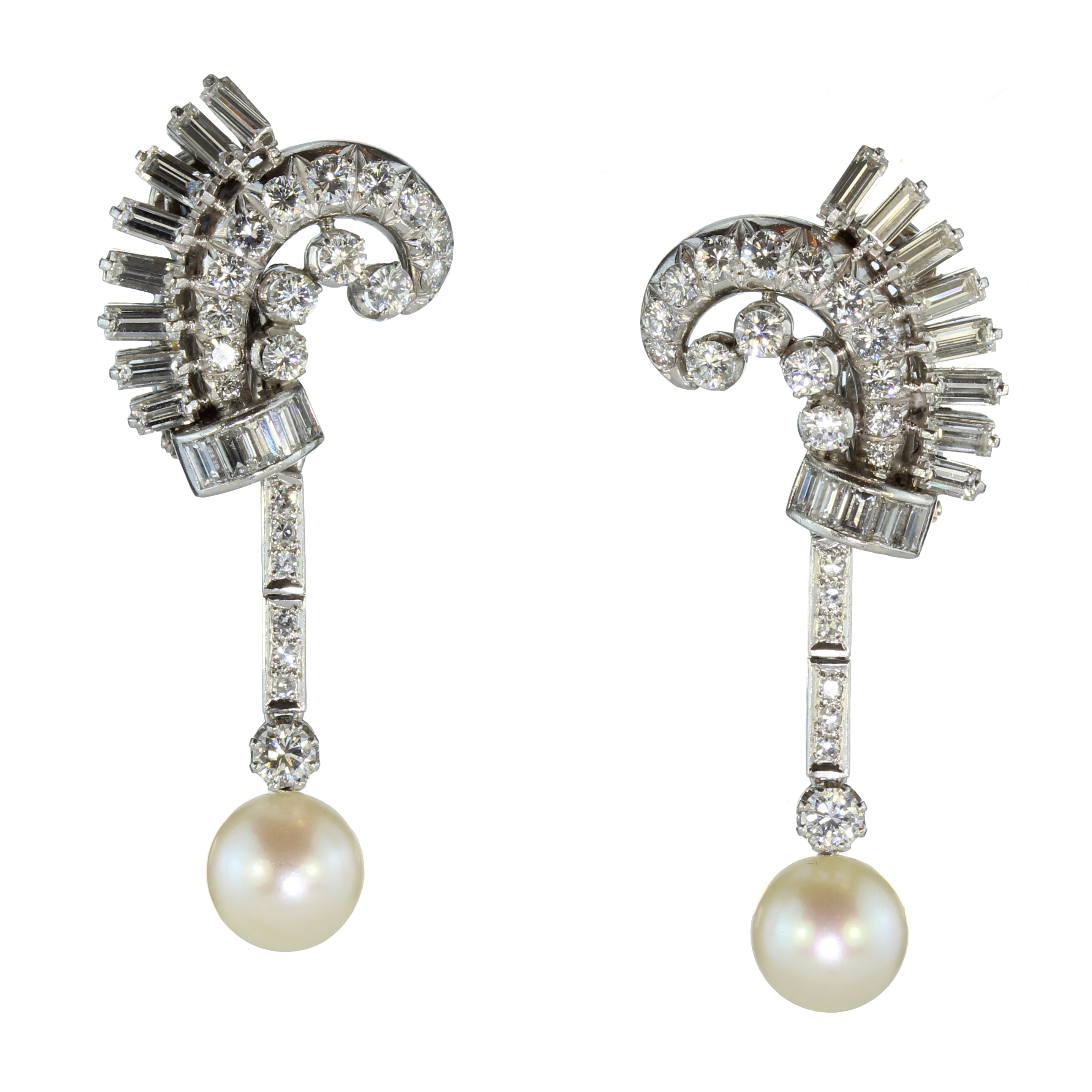 Los 26 - A pair of French diamond and pearl cocktail earrings in platinum each designed as a scrolling
