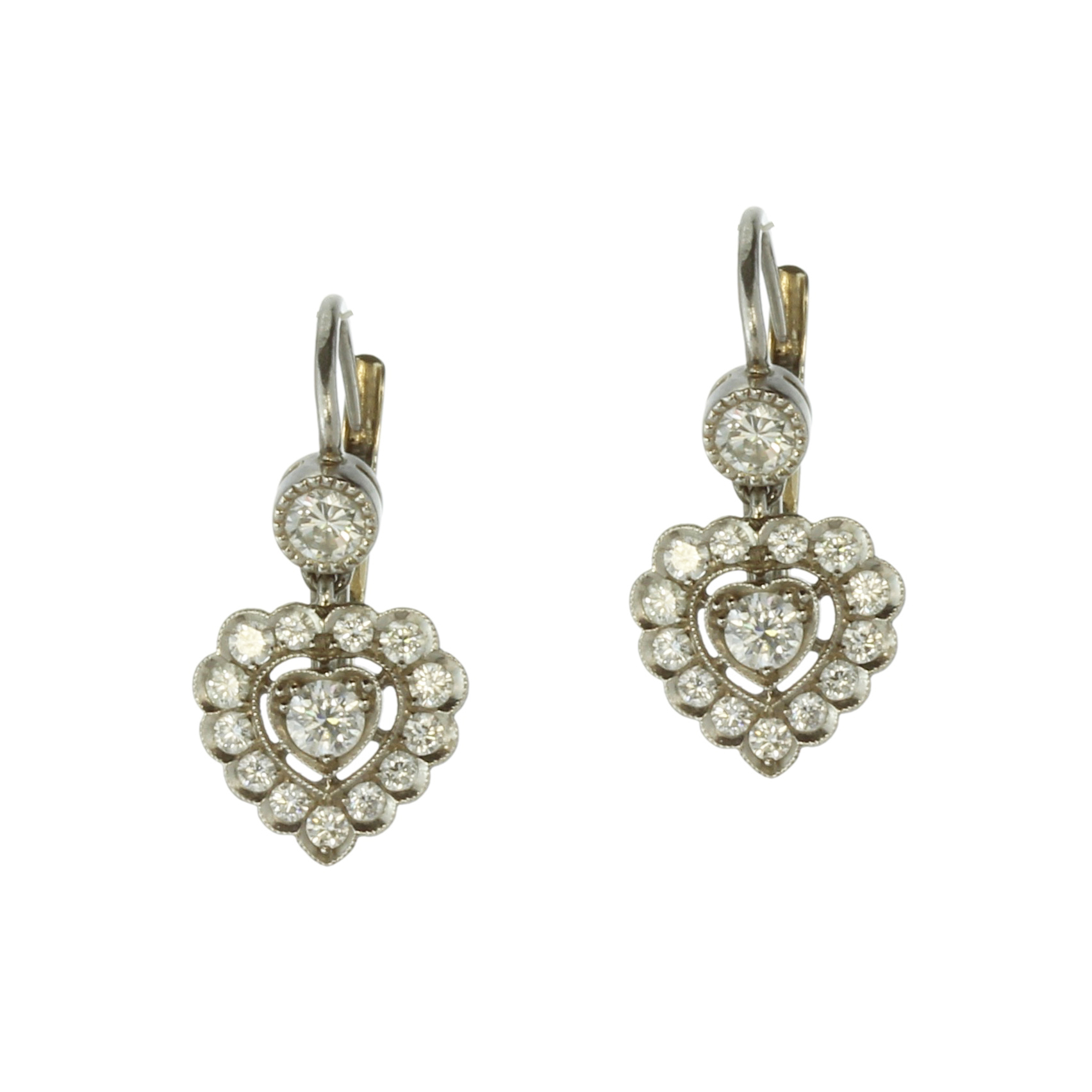 A pair of diamond cluster heart earrings in white gold or platinum, each set with a round cut