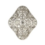 An antique Art Deco diamond scarf clip in 18ct white gold set with a central old round cut diamond