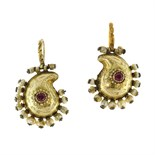 A pair of ruby and pearl earrings in high carat yellow gold each designed as a kidney shaped motif